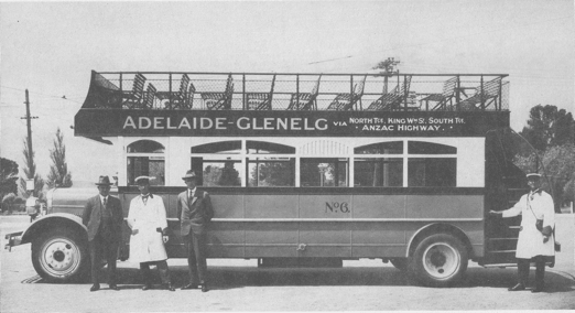 A.R. Thiem (left) handing over an early open-top Ruggles Bus for use on Glenelg line.